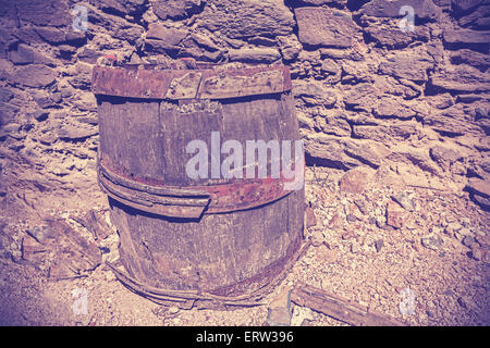 Vintage toned picture of old rusty wooden barrel cask. - Stock Photo