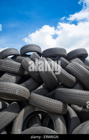 used car tyres in a pile - Stock Photo
