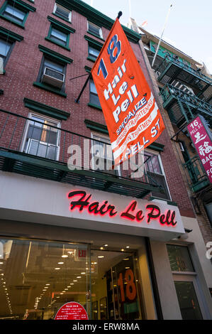 Hair Le Pell, a barber shop with hair stylists on Pell Street in Chinatown in New York City, a street with many - Stock Photo