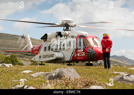 Ready for take-off, a Bristow Search and Rescue Helicopter taking over rescue duties from the RAF in North Wales - Stock Photo