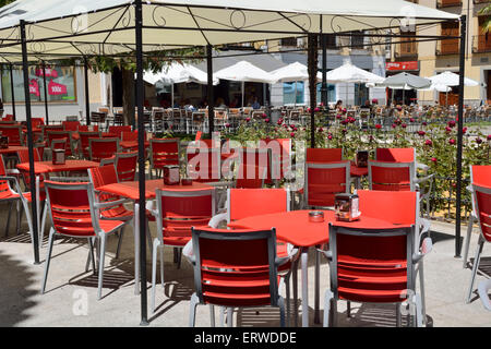 Empty tables and chairs in outdoor restaurant, Illescas, Spain - Stock Photo