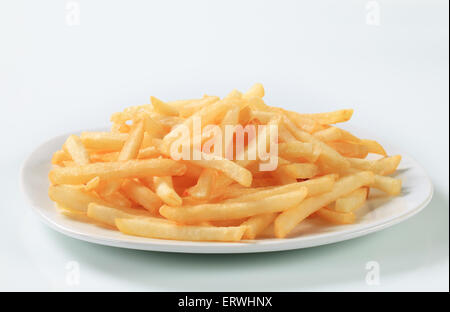 Fresh fried French fries on plate - Stock Photo