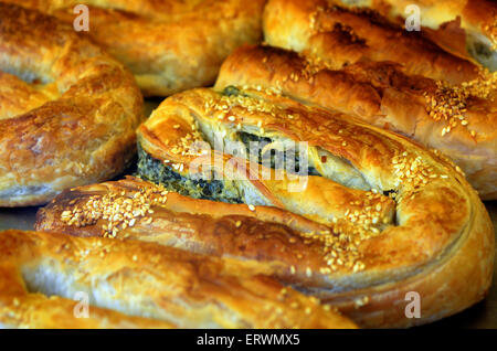 Balkans pastry borek on display in a bakery, food background and texture - Stock Photo