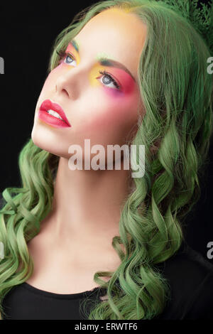 Imagination. Woman with Dyed hair and Fancy Creative Makeup - Stock Photo