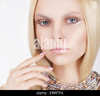 Sophisticated Lovely Blonde Touching Her Face - Stock Photo