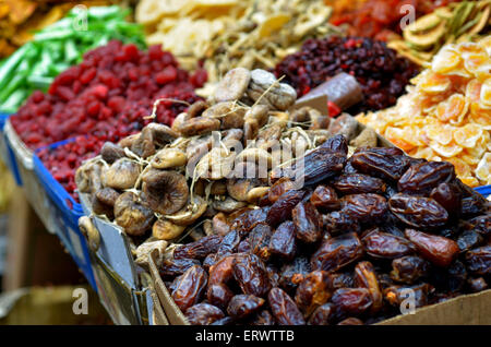 Dried fruits on display in food market in Tel Aviv, Israel. Food background and texture - Stock Photo