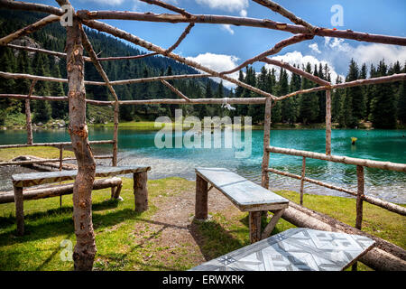 Summerhouse near mountain Saint lake in Gregory gorge of Kyrgyzstan, Central Asia - Stock Photo