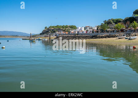 a view of the old fishing village taken from a boat on the sea - Stock Photo