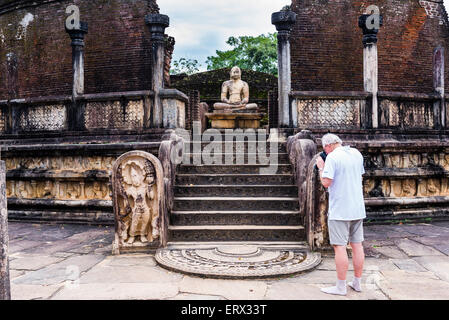 Ancient City of Polonnaruwa Quadrangle, tourist at the Vatadage (Circular Relic House), UNESCO World Heritage Site, - Stock Photo