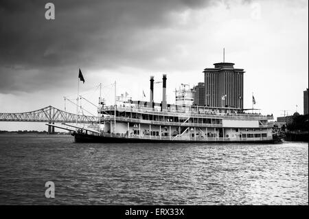 Paddlewheel riverboat sets sail on the Mississippi River from New Orleans - Stock Photo