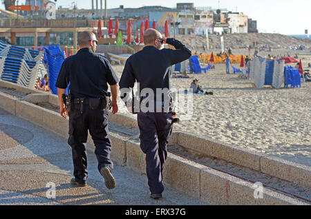 TEL AVIV, ISR - APR 07 2015:Two Israel Police officers patrolling on Tel Aviv waterfront.The Israel Police are a - Stock Photo