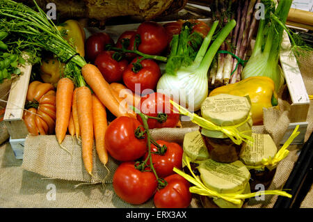 Fresh organic vegetables in wooden box with jute in a market - Stock Photo