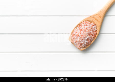 Himalayan salt on wooden spoon - Stock Photo
