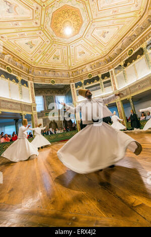 Whirling dervishes performing at Galata Mevlevi Museum, Istanbul, Turkey - Stock Photo