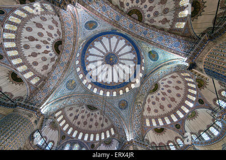 Low angle view of the main dome inside the Sultan Ahmed Mosque or Blue Mosque, Sultanahmet, Istanbul, Turkey - Stock Photo