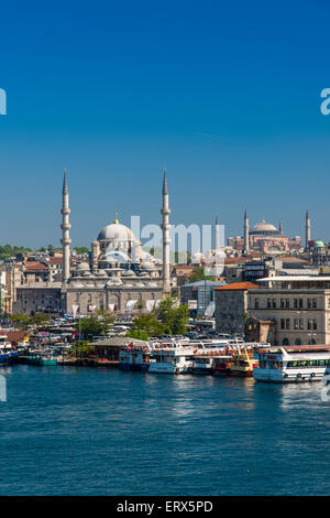 City skyline with Yeni Cami or New Mosque and Hagia Sophia, Istanbul, Turkey - Stock Photo