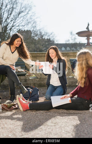 Female students studying in college campus - Stock Photo