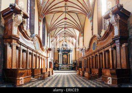 High alter of the Archcathedral Basilica of the Assumption of the Blessed Virgin Mary and Saint Andrew in Frombork, Poland. Stock Photo