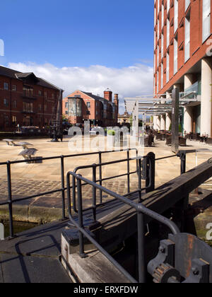 Old Lock Gate and Redeveloped Waterfront Area at Granary Wharf Leeds West Yorkshire England - Stock Photo