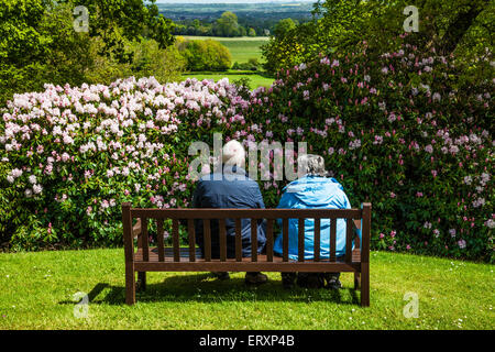An elderly couple enjoy the view from the mausoleum of the Bowood Estate over the landscape of Wiltshire. - Stock Photo