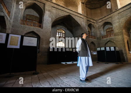 Visitors attend the Afghan calligraphy exhibition in Timur Shah Mausoleum, Kabul, Afghanistan - Stock Photo