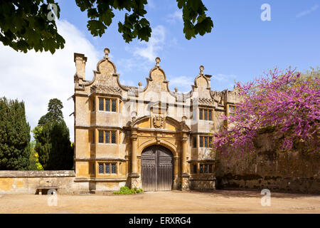 Springtime in the Cotswolds - The Jacobean gatehouse to Stanway Manor in the Cotswold village of Stanway, Gloucestershire - Stock Photo