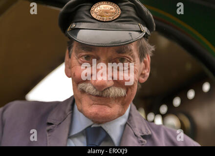 Friendly locomotive engineer of the Bluebell Railway at Horsted Keynes Station, West Sussex, England, United Kingdom. - Stock Photo