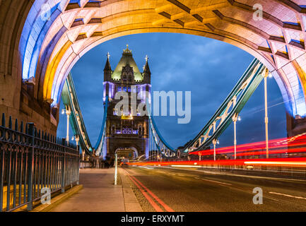 Bridge Tower night view from the bridge, London United Kingdom. A combined bascule and suspension bridge which crosses - Stock Photo