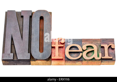 NO fear - isolated word abstract in mixed vintage letterpress printing blocks - Stock Photo