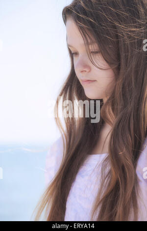 portrait of a pensive young teenage girl - Stock Photo