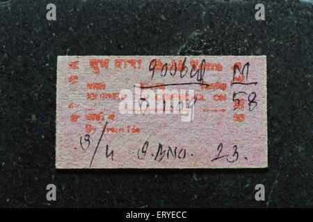 Train ticket of diesel locomotive train at Rajkot railway station ; Gujarat ; India - Stock Photo