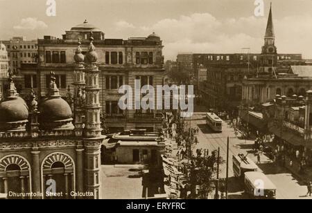 Old vintage 1900s Dharmatala Street now Lenin Sarani Calcutta Kolkata West Bengal India - Stock Photo