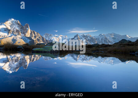 Mont Blanc massif reflected in the Lac des Chésery, Chamonix, Rhone-Alpes, France - Stock Photo
