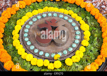 Om design pebbles flowers concentric circle India Asia - Stock Photo