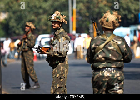 Military outside Taj Mahal hotel after terrorist attack by deccan mujahedeen ; Bombay Mumbai - Stock Photo