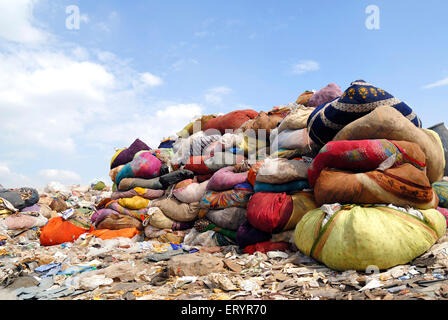 Rag bundles in dumping ground ; Deonar ; Bombay Mumbai ; Maharashtra ; India - Stock Photo