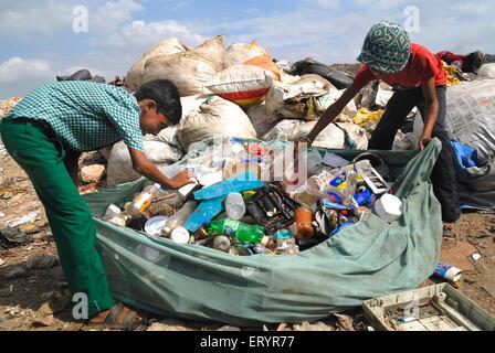 Rag pickers collecting garbage in dumping ground Deonar Bombay Mumbai Maharashtra India - asb 163523 - Stock Photo