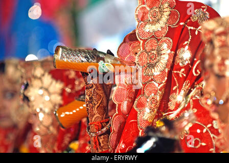 Muslim bride in veil drinking soft drink in marriage ceremony 15 June 2009 - Stock Photo
