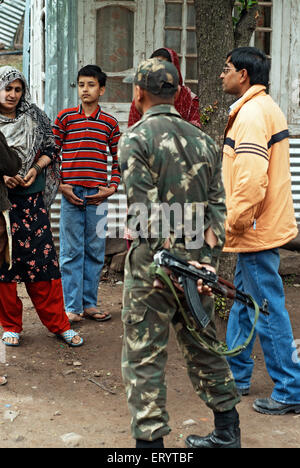 Border security force soldier interact with villager of Urusa ; Uri ; Jammu and Kashmir ; India NO MR 7 April 2008 - Stock Photo
