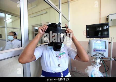 Nurses of kasturba hospital demonstrating use mask against swine flu patients in Bombay Mumbai ; Maharashtra ; India - Stock Photo