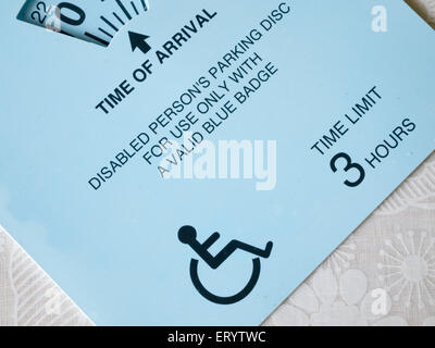 Disabled persons parking disc and permit (blue badge) - Stock Photo