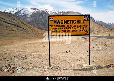 Sign board of Magnetic Hill ;  Leh ; Ladakh  ; Jammu and Kashmir  ; India - Stock Photo