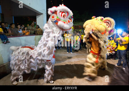 Chinese newyear celebration with lion mask dance competition ; Calcutta Kolkata ; West Bengal ; India - Stock Photo