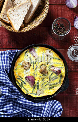 Scrambled eggs with onions and mushrooms, food - Stock Photo