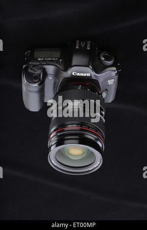 Digital camera with zoom lens ; India - Stock Photo