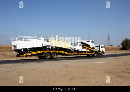 Transporting of  automobiles  by road carriers  on state highway - Stock Photo