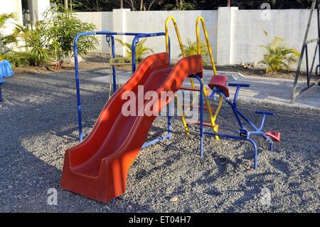 Slide in playground Gir at Gujarat India - Stock Photo