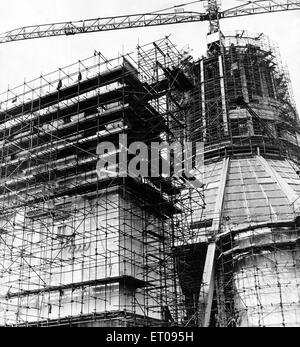 In a web of steel scaffolding, the main entrance to the Liverpool Metropolitan Cathedral rises alongside the central - Stock Photo