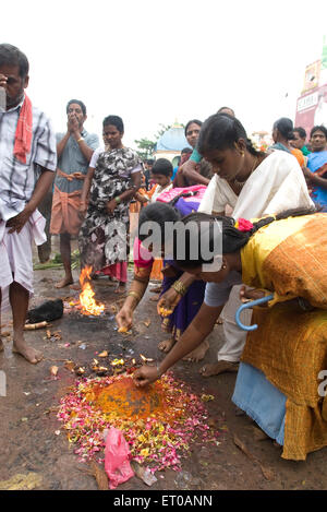 Worshipping in Arunachaleshwara temple dedicated to lord Shiva Chola Period 9th 13th century in Thiruvannamalai - Stock Photo