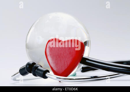 Red heart, Globe and stethoscope on white - Stock Photo